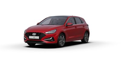 Front side view of the new Hyundai i30 in the colour Sunset Red.